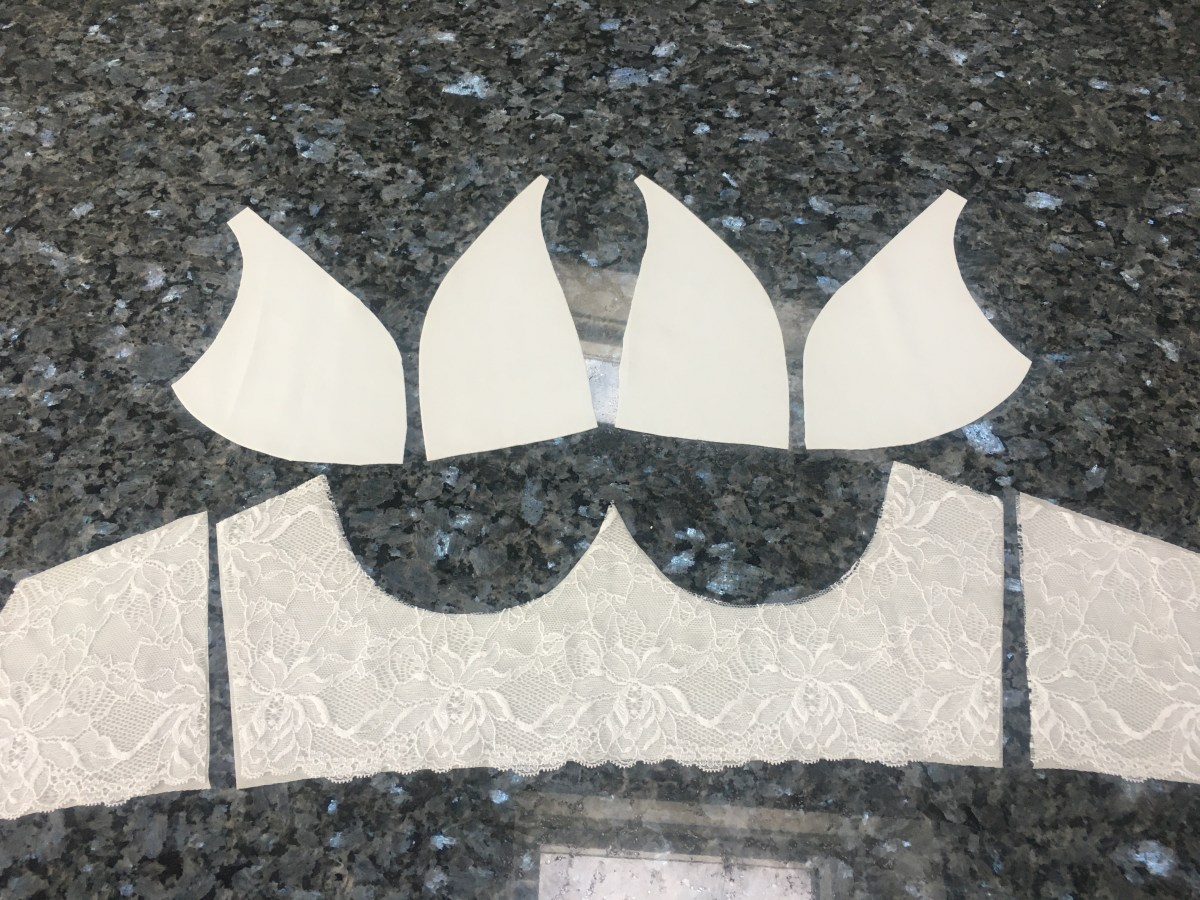 The cut out pieces of the bra, right side up. Each cup has two pieces, and theres a cradle and two back bands.