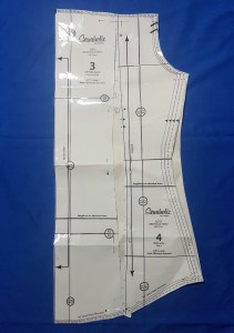 The two original back and side back pieces, overlaid on one solid piece of paper. There is a slight gap between the two along the waistline.