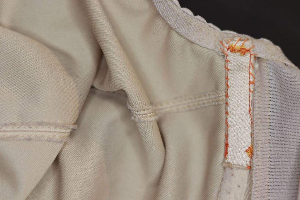 The other underarm end of the underwire, showing elastic that has been hand-sewn and machine stitched into place.