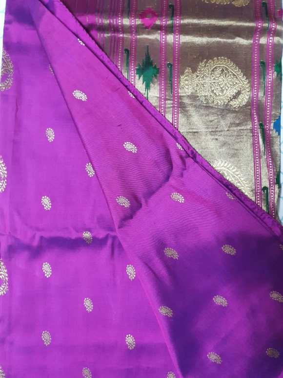The body of the purple Paithani showing the body of the piece with it's small all-over silver paisley pattern.