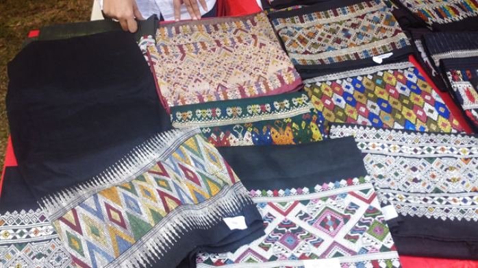 Image of a table with many colorful cuts of fabric