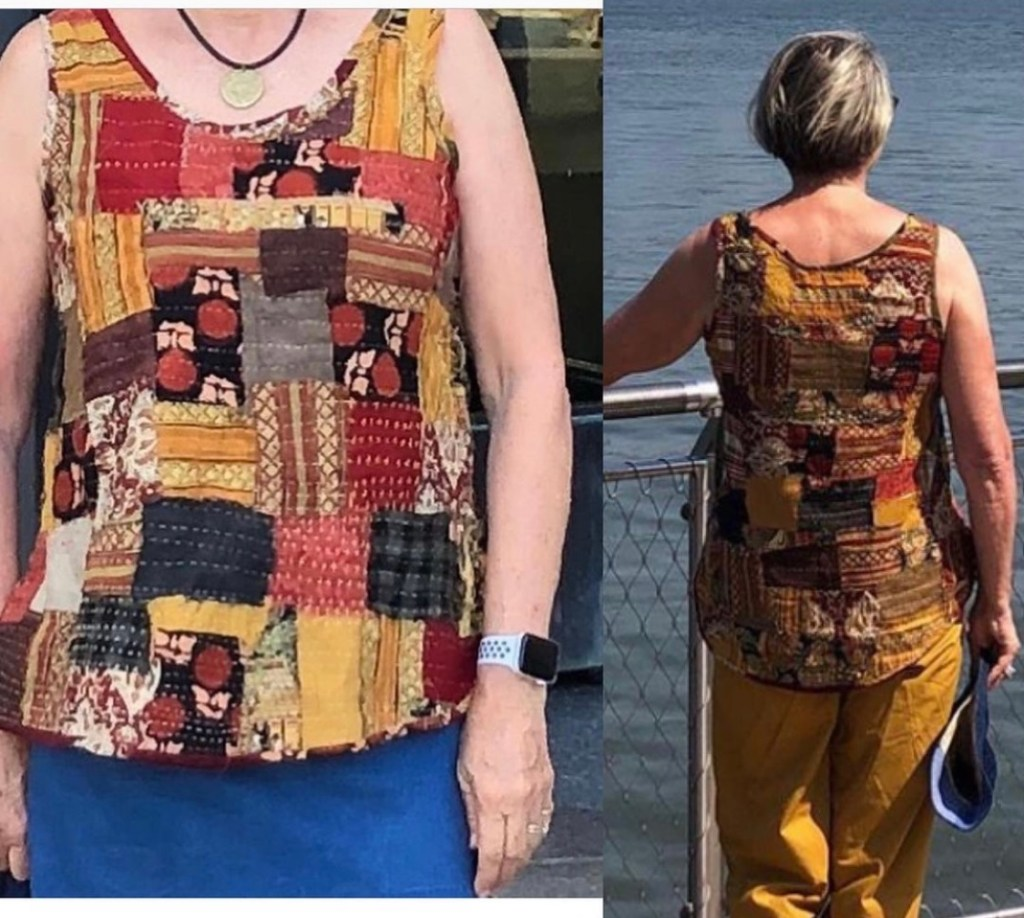 Woman wearing a tank top constructed from scraps of coordinating fabrics in autumn colours.