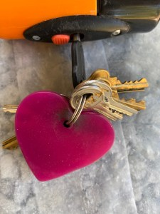 group of keys in a lock with a heart keyring.