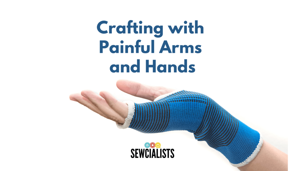 """Photo of a white-skinned hand and wrist covered in a flexible blue brace, palm facing upwards. Text above the photo says """"Crafting with Painful Arms and Hands"""" and the Sewcialists logo appears beneath the photo."""