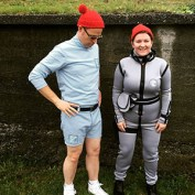 Author Kelly stands next to her partner Ralph; they are both wearing handmade costumes as Steve and Klaus (resp) from The Life Aquatic with Steve Zissou.