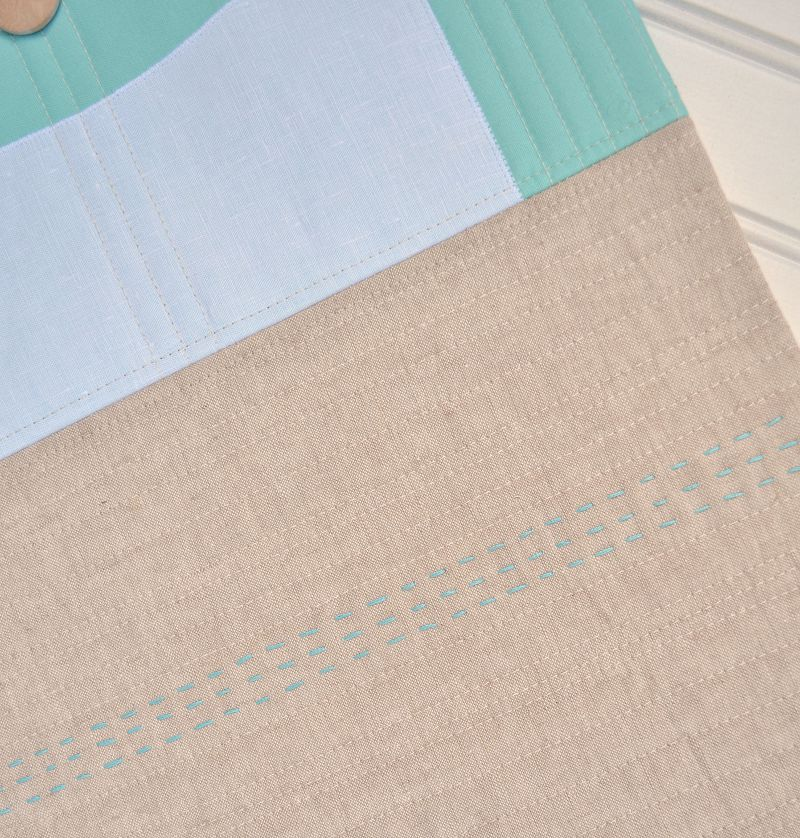 linen_and_blue_wall_hanging_detail