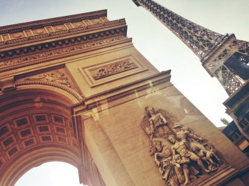 """Arc de triomphe"" + Eiffel Tower in front of Paris."
