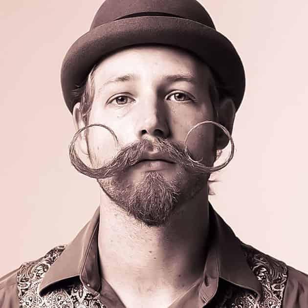 fancy beard style, crooked mustache with short beard