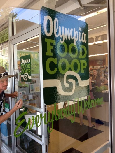 Enjoyed watching Ira Coyne paint the new Olympia Food Co-op logo on the doors of the West Side location. What a craftsman.