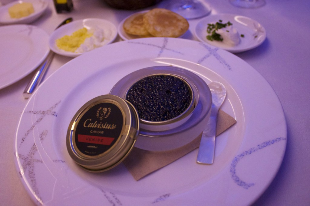 can of caviar with accompaniments