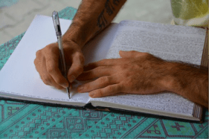 Person writing in diary