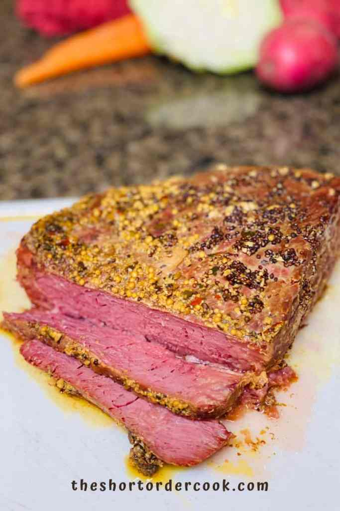Slow Cooker Corned Beef sliced on cutting board