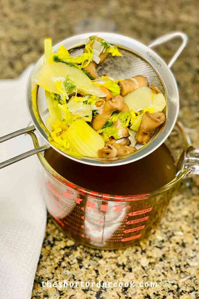Vegan Mushroom Broth scraps in the strainer
