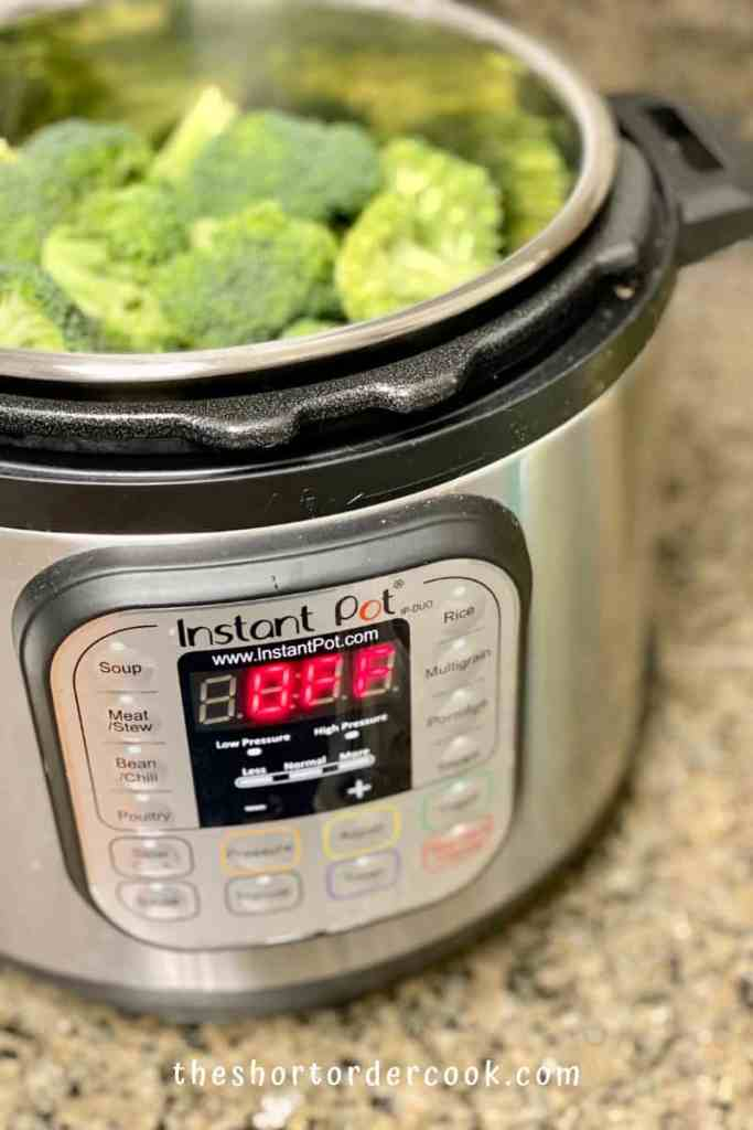 Instant Pot Steamed Broccoli steamer and broccoli in the insert