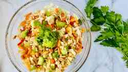 Asian Avocado Peanut Coleslaw featured closeup bowl and parsley but no serving utensils recipe card
