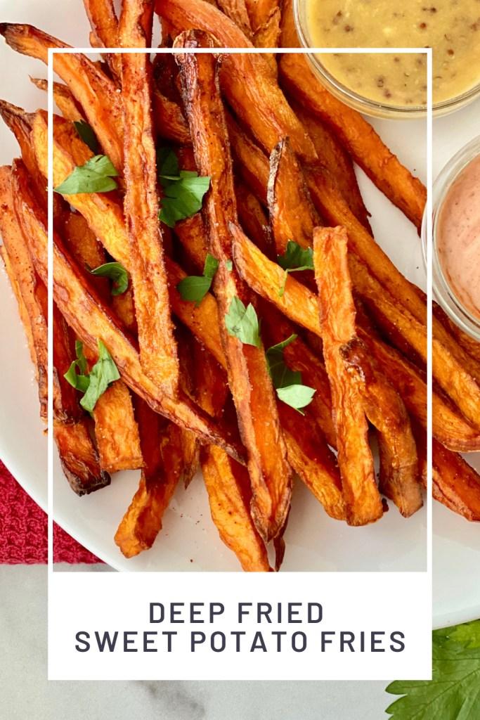 Deep Fried Sweet Potato Fries PINREDO closeup of shoestring sweet potato fries sprinkled with parsley