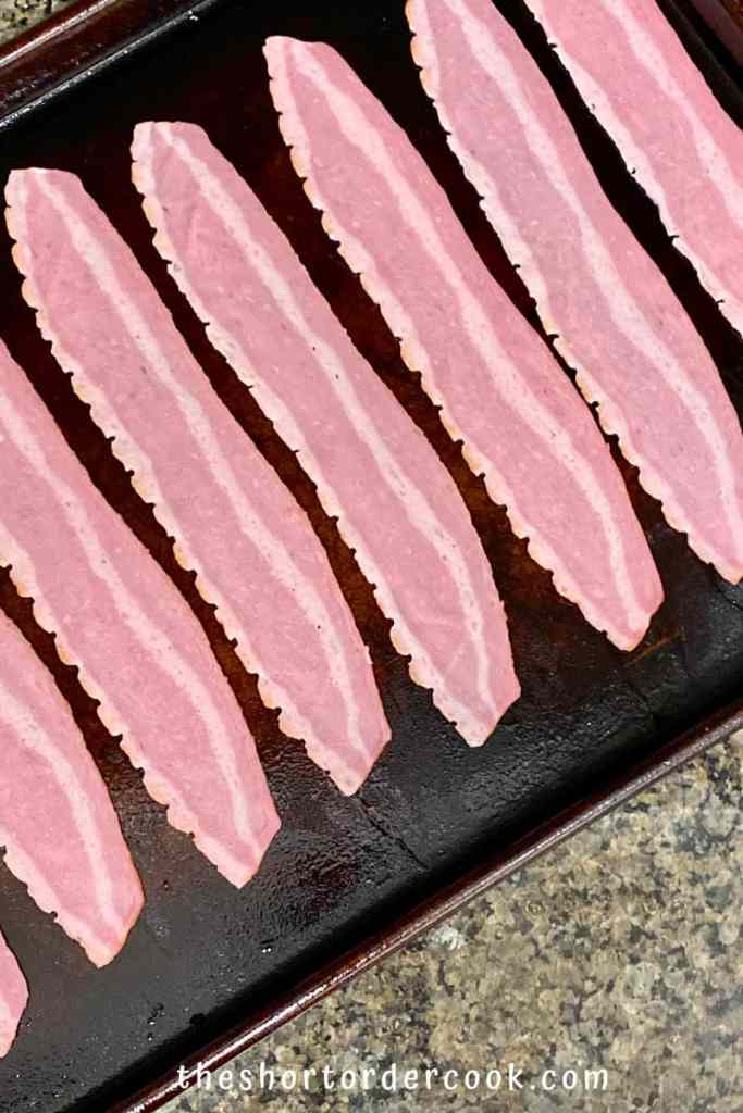 How to Cook Turkey Bacon in the Oven sheet pan lined with uncooked turkey bacon