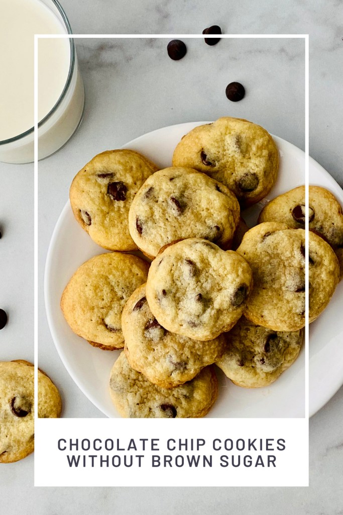 Chocolate Chip Cookies without Brown Sugar PINREDO overhead image of a white plate piled up with cookies and a glass of milk to the side
