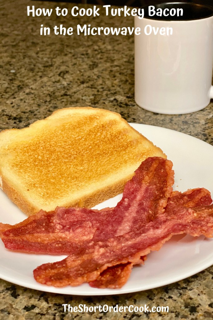 How to Cook Turkey Bacon in the Microwave Oven PN1 a white plate with 3 strips cooked bacon a slice of toast and a coffee mug in the background