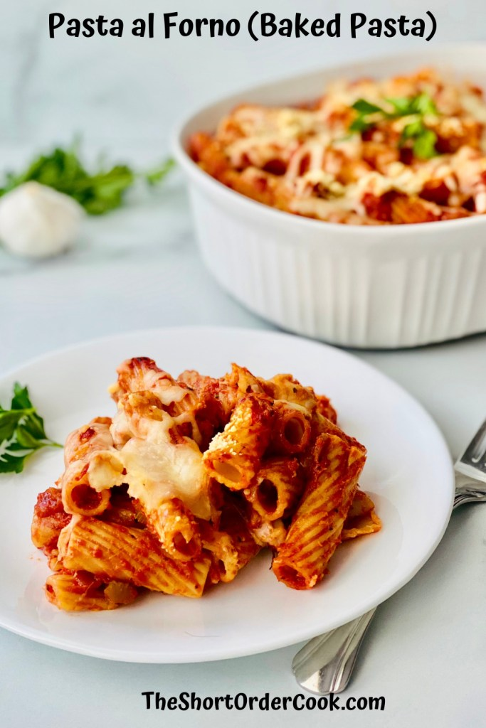 Pasta al Forno (Baked Pasta) PN1 a plate with pasta and the casserole dish in the background