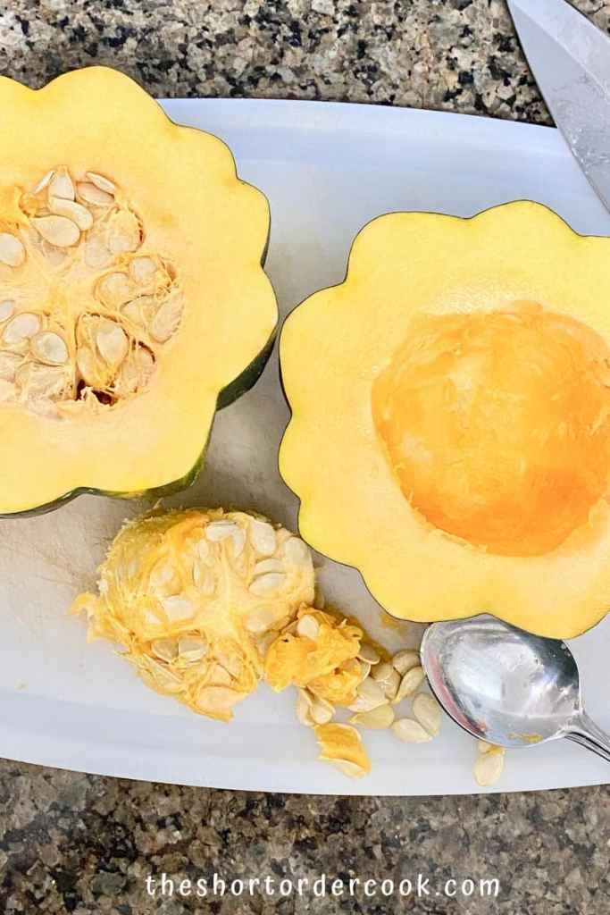 Slow Cooker Brown Sugar Acorn Squash cut in half and one side has the seeds scooped out
