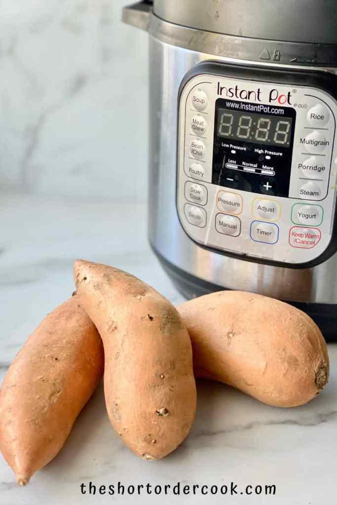 Instant Pot Cubed Sweet Potatoes ingredients 3 whole sweet potatoes and the instant pot on the counter