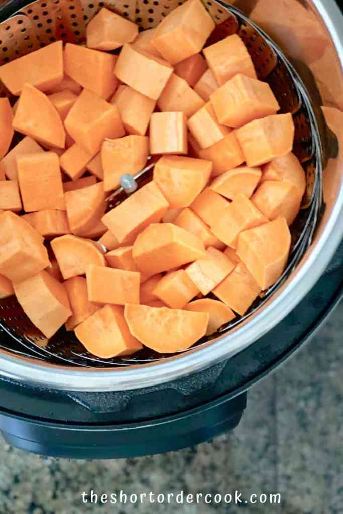 Instant Pot Cubed Sweet Potatoes raw on the steamer insert in the pressure cooker