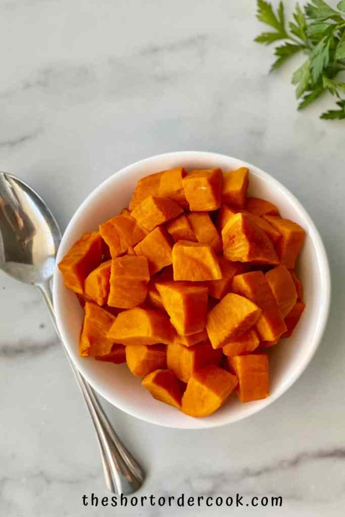 Instant Pot Cubed Sweet Potatoes ready to eat in a bowl with a spoon