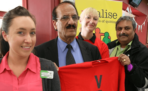 ​Councillor Mohammed Khan (centre) with stop smoking administrator Paula Dobson (centre right) and Asda workers Bharrat Palmer (right) and Kayleigh Wolfenden (left)