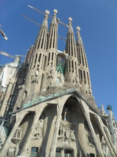 Right at the foot of the La Sagrada Família looking up at it awe.