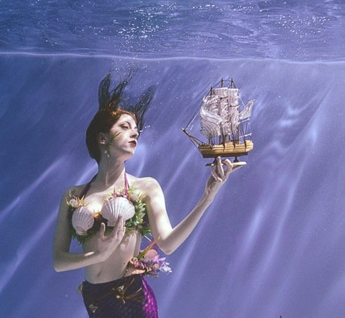 mermaid holding a model ship underwater david ballard