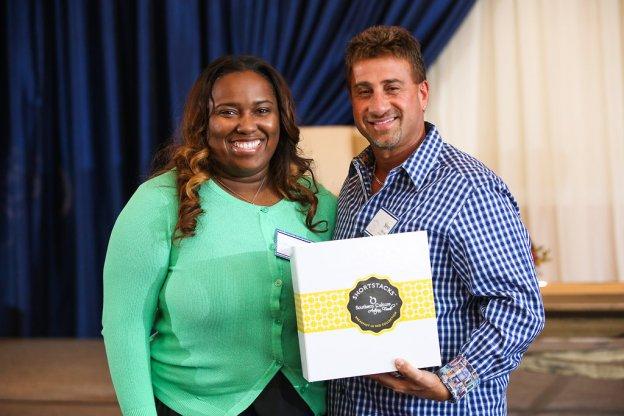 Attendee winning Shortstacks Pancakes gift box from Speaker, Erica Barret of Southern Culture Artisan Foods