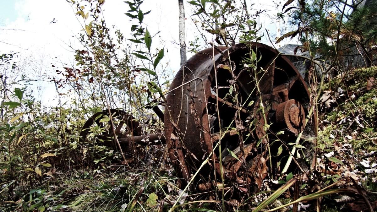 Rusty wheels itching to roll again. Seen near Post #13(Stiff Arm Derrick Site). Becket Quarry, MA