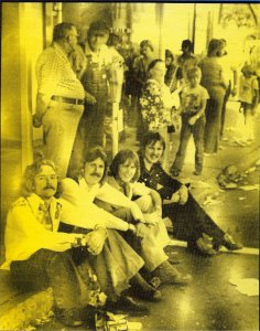 "A photo from the back of the album cover for ""Sailing On Fantasies"". We were in downtown Worthington, MN during a summer parade. From left: Paul Staack, Ken Wiles, Mick Orton and Jon Ludtke. The two older gentlemen never saw us... didn't care and didn't move much even after we left."
