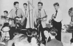 Quarrymen On Stage: from left: Paul, tea chest bass player, John and another guitarist
