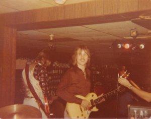 Ken's back, Jon and Mick tuning his bass