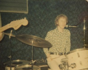 Kim on drums singing
