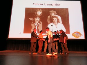 Silver Laughter receiving plaques