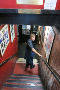 Mick walking down the stairs to the new Cavern Club