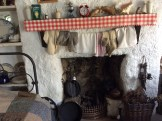 The open fireplace with clothes drying above