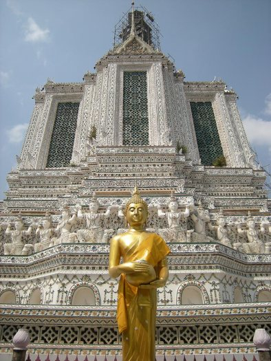 A Buddha statue at the base of Wat Arun