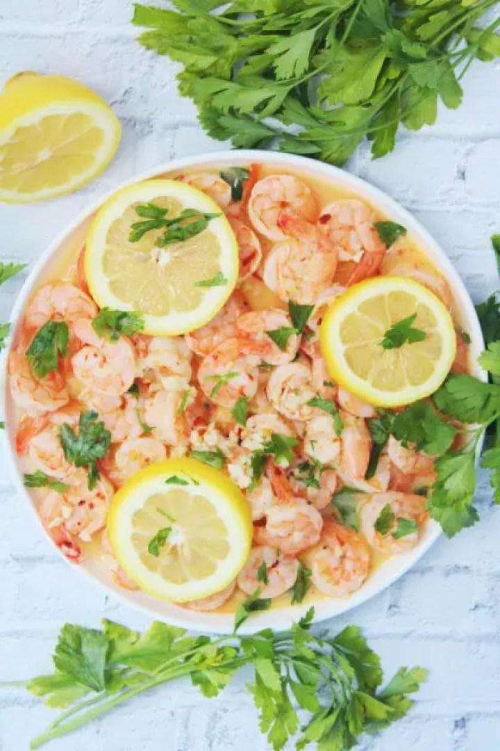 Camarones al ajillo or garlic shrimp is served with crusty bread