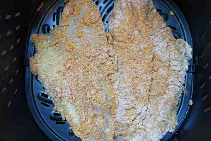Air frying the crispy catfish fillets.
