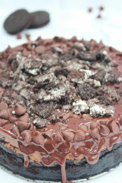 Chocolate cheesecake is made with chocolate ganache, cream cheese, sugar, sour cream, cocoa powder, vanilla extract, oreo cookies, melted chocolate and a few other ingredients.