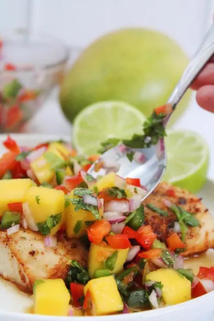Easy mango habanero salsa recipe being served.