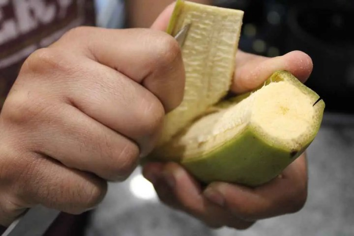 Gently pull the peel off the plantain using a knife.