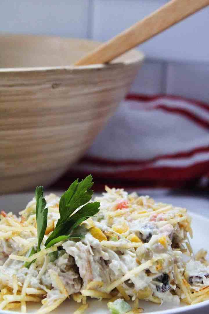 Add Batata Palha to the salpicao de frango and serve.