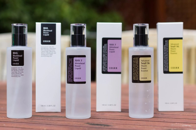 The lineup: BHA Blackhead Power Liquid, AHA Whitehead Power Liquid, and Advanced Snail 96 Mucin Power Essence in their black, purple and yellow packaging.