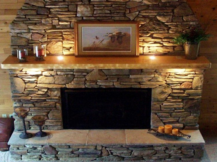 Get The Warmth of Charming Stacked Stone Fireplace Design in Your Living Room 2