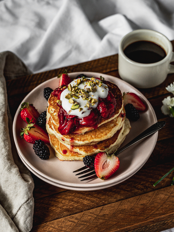 pancakes on a plate with strawberry compote
